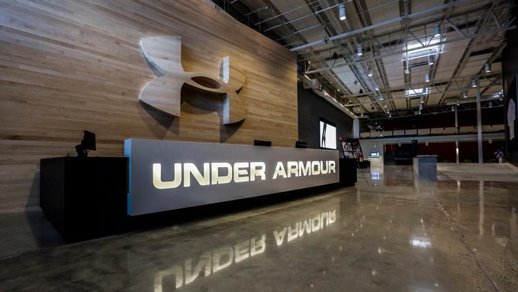 Under Armour faces smaller loss than expected on e-commerce strength