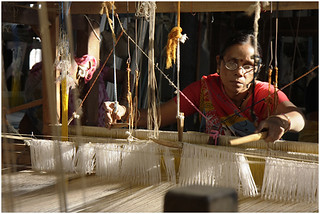 Weavers and traders from surat continue to wrangle for transportation cost.